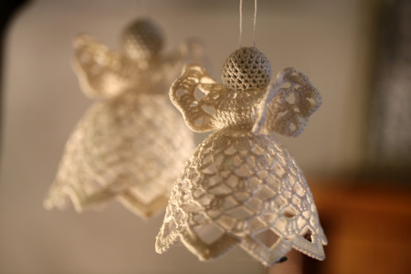 hand crafted: Knitted Christmas angel hanging on bud