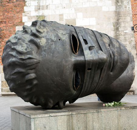 eros: Sculpture by Igor Mitoraj Eros Bendato on the Main Square in Cracow. Poland