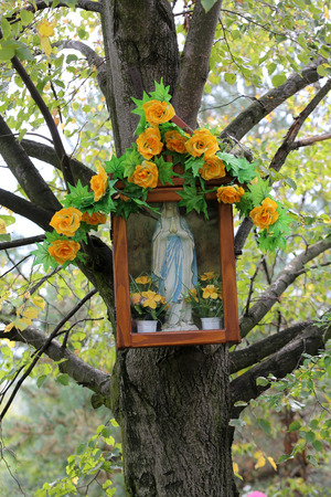 reverence: Old Wayside shrine in Mucharz near Cracow. Poland Stock Photo