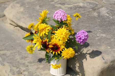 pistil: the beautiful bouquet from sunflowers, hydrangeas and chrysanthemums Stock Photo