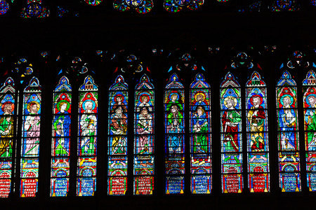 north window arch: Stained glass windows inside the Notre Dame Cathedral, UNESCO World Heritage Site. Paris, France