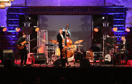 the quartet: WIELICZKA, POLAND - NOVEMBER 2, 2015: Adam Kawonczyk Quartet playing live music at The Cracow Jazz All Souls' Day Festival in The Wieliczka Salt Mine. Poland Editorial