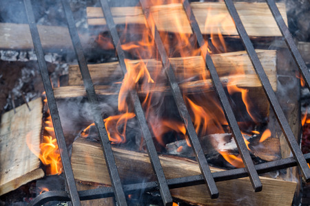 grill: Empty Barbecue Grill With Bright Flames Closeup
