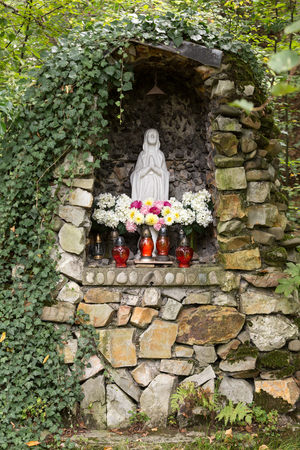 devotional: Old Wayside shrine in Mucharz near Cracow. Poland Stock Photo