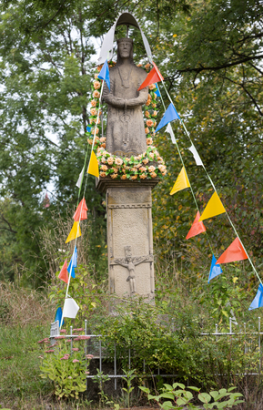 wayside: Old Wayside shrine in Mucharz near Cracow. Poland Stock Photo