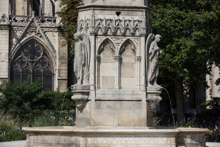 fontaine: Paris - Fountain of Virgin in Square Jean XXIII near east side of Cathedral Notre Dame