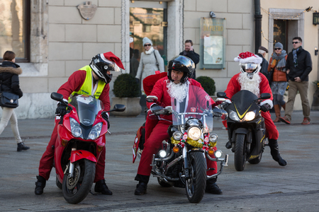 main market: CRACOW, POLAND - DECEMBER 6, 2015: CRACOW, POLAND - DECEMBER 8, 2013: the parade of Santa Clauses on motorcycles around the Main Market Square in Cracow. Poland Editorial