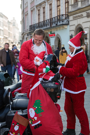 clauses: CRACOW, POLAND - DECEMBER 6, 2015: CRACOW, POLAND - DECEMBER 8, 2013: the parade of Santa Clauses on motorcycles around the Main Market Square in Cracow. Poland Editorial