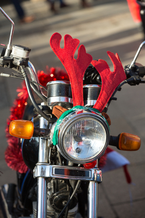 clauses: CRACOW, POLAND - DECEMBER 6, 2015: the parade of Santa Clauses on motorcycles around the Main Market Square in Cracow. Poland
