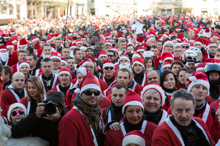 main market: CRACOW, POLAND - DECEMBER 6, 2015: the parade of Santa Clauses on motorcycles around the Main Market Square in Cracow. Poland