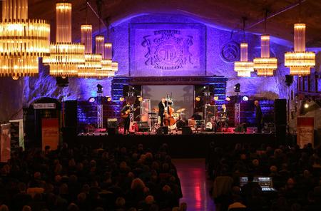 WIELICZKA, POLAND - NOVEMBER 2, 2015: Adam Kawonczyk Quartet playing live music at The Cracow Jazz All Souls' Day Festival in The Wieliczka Salt Mine. Poland Editorial