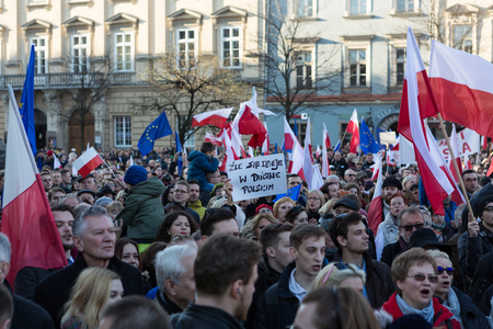 constitutional: CRACOW, POLAND - DECEMBER 19, 2015: Cracow, Main Square -  The demonstration of the Committee of the Defence Protection of the Democracy against the break of law through the government PIS in Poland.
