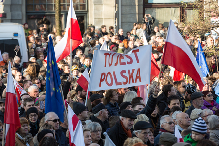 CRACOW, POLAND - DECEMBER 19, 2015: Cracow, Main Square - The demonstration of the Committee of the Protection of Democracy  KOD against the break of law through the government PIS in Poland. Editorial