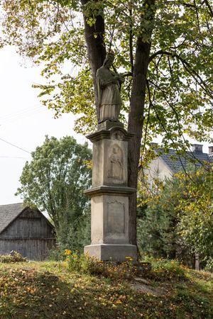 wayside: Old Wayside shrine in Siepraw near Cracow. Poland Stock Photo