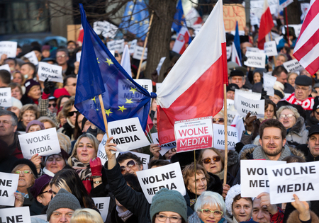 dictatorship: CRACOW, POLAND - JANUARY 9, 2016:  -  The demonstration of the Committee of the Defence  of the Democracy  KOD  for free media wolne media and democracy against PIS government. Cracow , Poland Editorial
