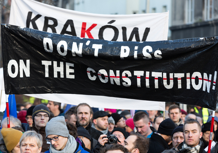 constitutional: CRACOW, POLAND - JANUARY 9, 2016:  -  The demonstration of the Committee of the Defence  of the Democracy  KOD  for free media wolne media and democracy against PIS government. Cracow , Poland Editorial