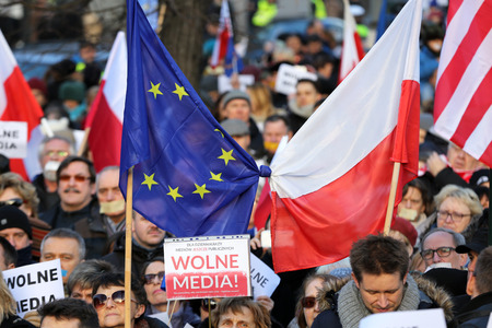 polish flag: CRACOW, POLAND - JANUARY 9, 2016:  -  The demonstration of the Committee of the Defence  of the Democracy  KOD  for free media wolne media and democracy against PIS government. Cracow , Poland Editorial