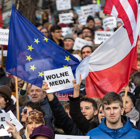 committee: CRACOW, POLAND - JANUARY 9, 2016:  -  The demonstration of the Committee of the Defence  of the Democracy  KOD  for free media wolne media and democracy against PIS government. Cracow , Poland Editorial