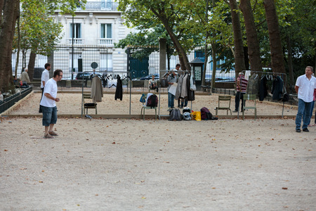 petanque: Playing petanque in the late afternoon in Luxemburg Garden in Paris, France