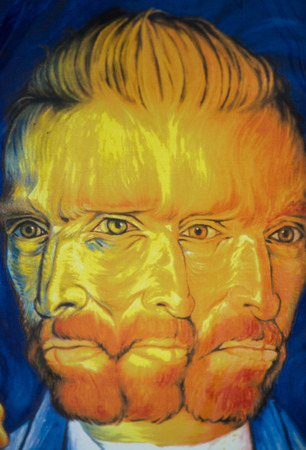 likeness: The abstract and psychedelic poster with the likeness Vincent Van Gogh.  Second-hand book market on quai of river Seine. Paris, France