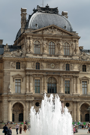 faade: Paris - Architectural fragments of the Louvre building. The Louvre Museum is one of the largest and most visited museums worldwide. Stock Photo