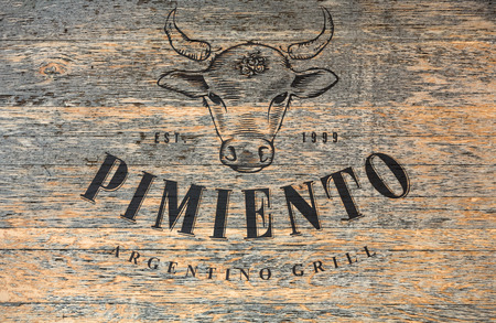 pimiento: CRACOW, POLAND - JANUARY 30, 2016: vintage signboard restaurant Pimiento in Kazimierz district in Cracow, Poland Editorial