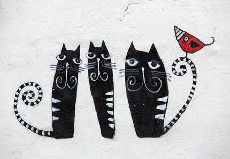 cat goddess: CRACOW, POLAND - JANUARY 30, 2016: Street art  in Kazimierz district in Cracow,  Poland.  Kazimierz is the perfect place to walk in the back alleys and abandoned areas, looking for fresh air and street art.