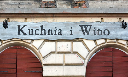 wino: CRACOW, POLAND - JANUARY 30, 2016: vintage signboard restaurant Kuchnia i Wino in Kazimierz district in Cracow, Poland