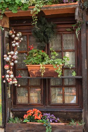 plaster of paris: Window decorated with Geranium flowers in Montmartre Stock Photo