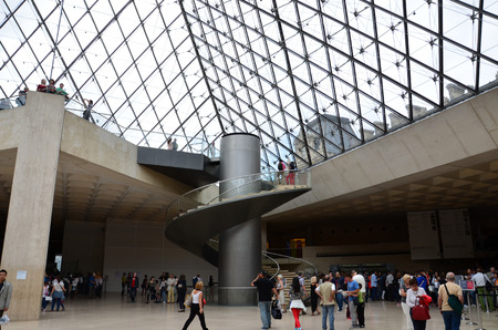 louvre pyramid: PARIS, FRANCE - SEPT 11, 2014:  People with Louvre Pyramid on September 11 2014. it was designed by the architect I. M. Pei in 1984. Paris, France