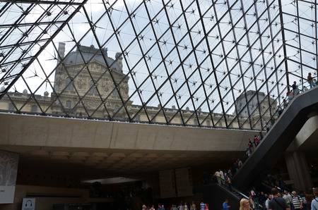 louvre pyramid: PARIS, FRANCE - SEPT 11, 2014:  People in Louvre Pyramid on September 11 2014. it was designed by the architect I. M. Pei in 1984. Paris, France