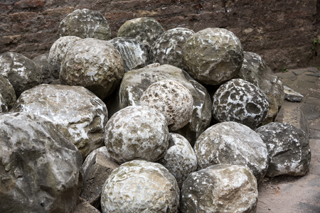 a war historian: Ancient marble cannonballs in Castel SantAngelo in Rome, Italy