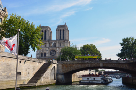 tour boats: PARIS, FRANCE - SEPT 9, 2014:  View of the Seine River with cruise tour boats. In Paris there are several boat tourist trips across the Seine to show tourists the sights of interest.