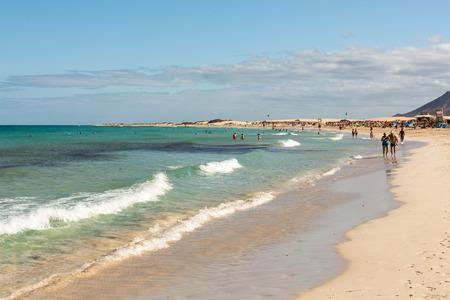 azure: Tourists rest on Corralejo Beach on Fuerteventura, Canary Islands