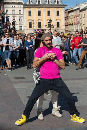 rhythms: CRACOW, POLAND - APRIL 2, 2016: International Flashmob Day of Rueda de Casino, 57 countries, 160 cities. Several hundred persons dance Hispanic rhythms on the Main Square in Cracow. Poland