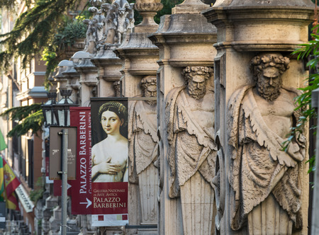 atlantes: ROME, ITALY - JUNE 11, 2015: Fencing of Palazzo Barberini (Galleria Nazionale dArte Antica) with columns with the image atlantes, Rome, Italy. Editorial