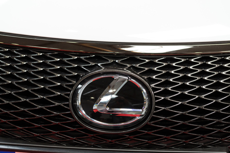 lexus: CRACOW, POLAND - MAY 21, 2016: Lexus metallic brand closeup on the Lexus car displayed at 3rd edition of MOTO SHOW in Cracow Poland. Exhibitors present  most interesting aspects of the automotive industry