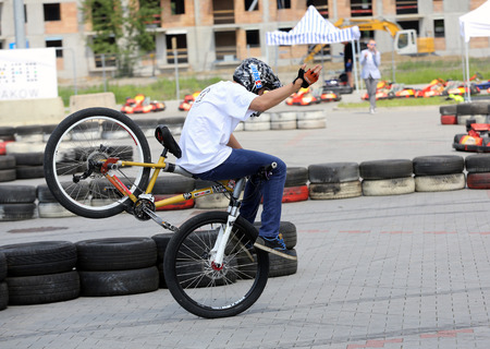 bmx bike: CRACOW, POLAND - MAY 21, 2016: Unidentified young man rides his BMX Bike  at 3rd edition of MOTO SHOW in Krakow.