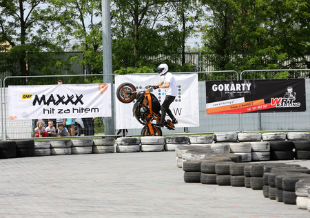 stunt: CRACOW, POLAND - MAY 21, 2016:  A stunt rider on a sport bike at 3rd edition of MOTO SHOW in Cracow. Poland.