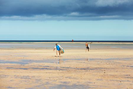 windsurfers: Windsurfers on the beach of Costa Calma in Fuerteventura, Canary Island. Spain