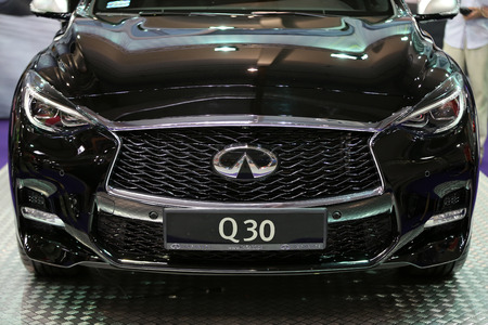 aspects: CRACOW, POLAND - MAY 21, 2016: Infiniti metallic brand closeup on the Infiniti car displayed at 3rd edition of MOTO SHOW in Cracow Poland. Exhibitors present  most interesting aspects of the automotive industry
