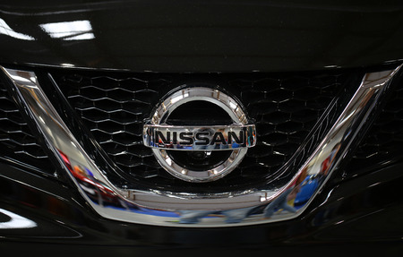 nissan: CRACOW, POLAND - MAY 21, 2016: Nissan metallic logo closeup on Nissan car displayed at 3rd edition of MOTO SHOW in Cracow Poland. Exhibitors present  most interesting aspects of the automotive industry