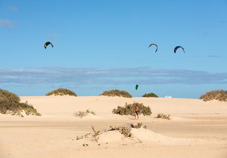 kiteboarding: Kite surfers in the beaches of Fuerteventura, Spain