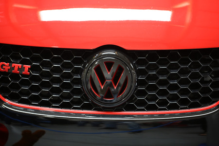 vw: CRACOW, POLAND - MAY 21, 2016: VW metallic brand closeup on VW  car displayed at 3rd edition of MOTO SHOW in Cracow Poland. Exhibitors present  most interesting aspects of the automotive industry Editorial