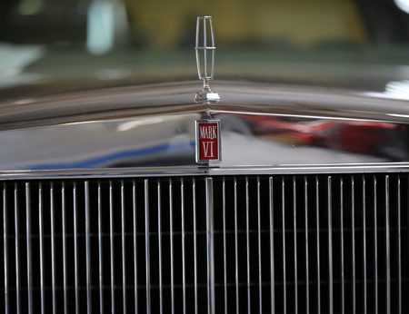 vi: CRACOW, POLAND - MAY 21, 2016:  Lincoln Continental Mark VI metallic brand closeup on Lincoln Continental Mark VI car displayed at 3rd edition of MOTO SHOW in Cracow Poland.