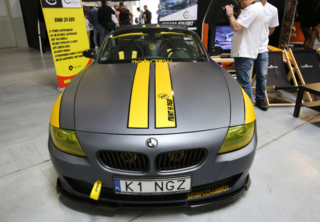 aspects: CRACOW, POLAND - MAY 21, 2016: Engine tuning BMW Cabrio displayed at 3rd edition of MOTO SHOW in Krakow. Poland. Exhibitors present  most interesting aspects of the automotive industry