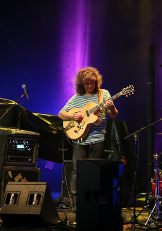 pat: CRACOW, POLAND - JUNE 26, 2016: Pat Metheny playing on acoustic guitar at Summer Jazz Festival in Cracow, Poland.