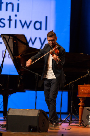 solo violinist: CRACOW, POLAND - JUNE11, 201: Adam Baldych -  Polish violinist  playing live music at Summer Jazz Festival in Cracow, Poland