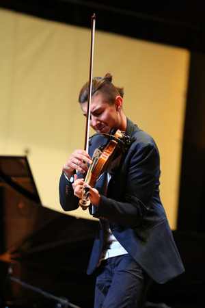 rhythms: CRACOW, POLAND - JUNE11, 201: Adam Baldych -  Polish violinist  playing live music at Summer Jazz Festival in Cracow, Poland