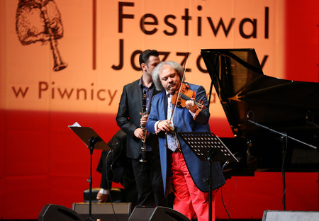 rhythms: CRACOW, POLAND - JUNE11, 201: Roby Lakatos  Romani violinist from Hungary  playing live music at Summer Jazz Festival in Cracow, Poland